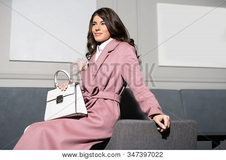 Model Dressed In Fashionable Clothes Posing Indoors