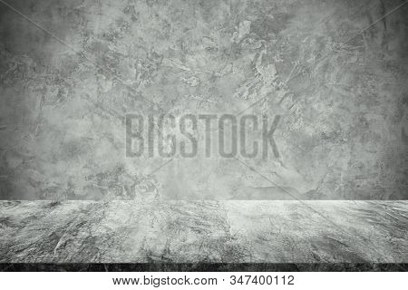 Empty Concrete Table With Raw Concrete Wall Background. For Display Or Montage Your Products.