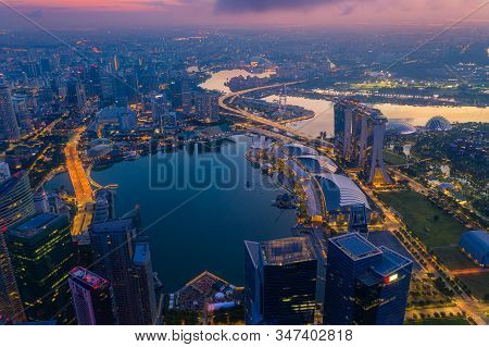 Aerial View Of The Singapore Landmark Financial Business District At Sunrise Scene With Skyscraper A