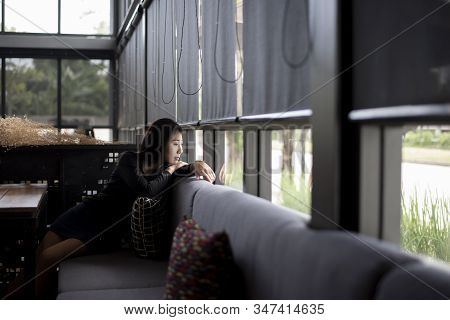 Asian Woman Sadness,broken Heart And Depressed About Bad Relationship.young Thoughtful Girl Sitting
