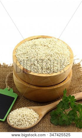 Healthy Food - Fresh White Sesame Seed In Wooden Bowl