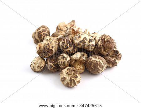 Heap Of Dry Shiitake Mushrooms Isolated On White Background
