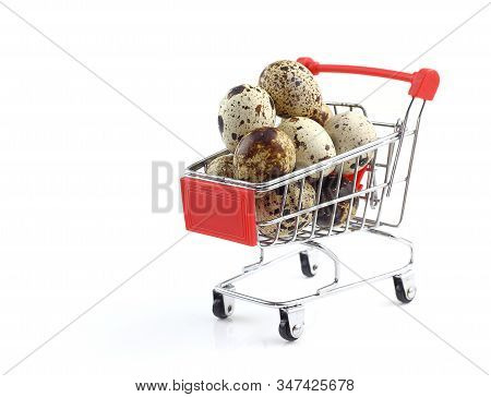 Heap Of Quail Eggs In Shopping Cart Isolated On White