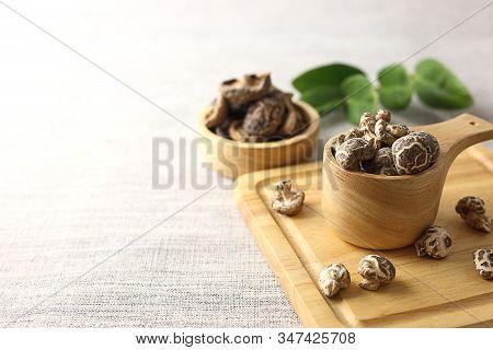 Closed Up Of Dry Shiitake Mushrooms On Cutting Board