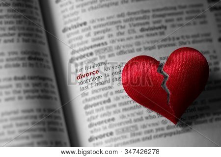 Red Broken Heart On Dictionary Divorce Definition. The Concept Of Divorce, Parting, Infidelity . Sel