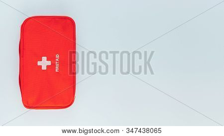 Red Bag With Home First Aid Kit. Box For Various Medicines, Vitamins, Drugs, Antibiotics And Other M