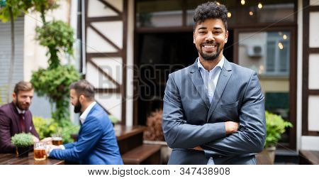 Young Male Business Owner Standing Near His New Local. Startup, Entrepreneur, Business Concept.