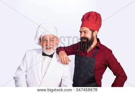 Two Chefs Cooking. Chefs In Uniform. Healthy Food. Chief Cook And Professional Culinary. Professiona