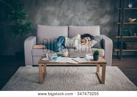 Nice Attractive Lovely Calm Sleepy Peaceful Wavy-haired Girl Lying On Divan Having Rest In Modern Lo