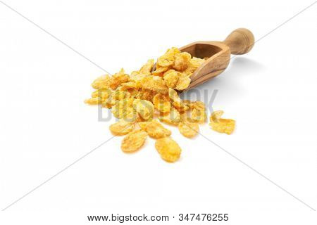 Corn flakes in scoop on white background