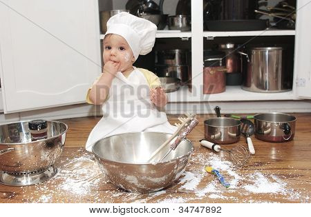 Baby making a mess in the kitchen