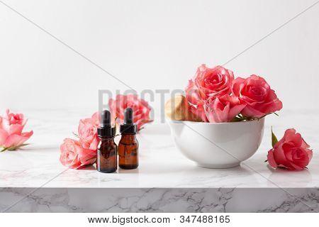 essential oils in bottles rose flowers. alternative medicine aromatherapy
