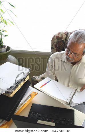Businessman reading manual