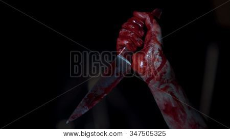 Mad Serial Killer Gripping Knife Covered In Blood, Hands Of Ruthless Maniac