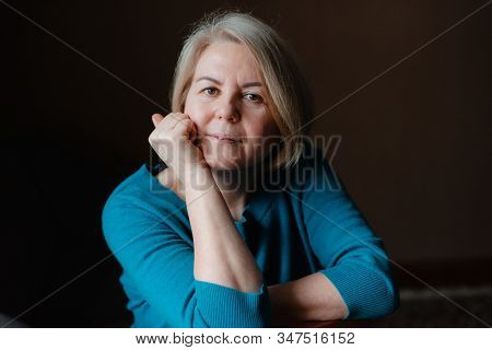 Portrait Of An Elderly Happy Well-groomed Beautiful Woman Blonde Pensioner 50-60 Years Old With Ligh