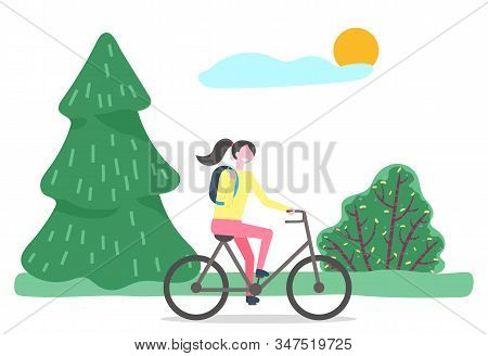 Woman Character Cycling In Park In Summer Time. Female Sitting On Bicycle Near Green Tree And Bush.