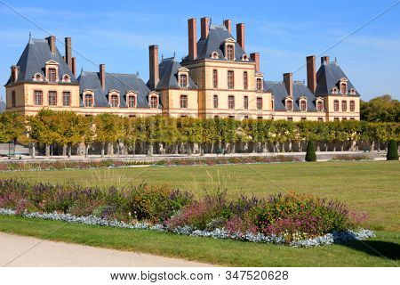 FONTAINEBLEAU, FRANCE - SEPTEMBER 16, 2019: Quartier Henri IV viewed from the Grand Parterre. The Grand Parterre is the largest formal garden in Europe, created between 1660 and 1664