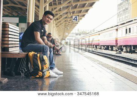 Cheap Travel And Lifestyle Concept.holiday Time,young Solo Traveler Man Wearing Sneaker And Sitting