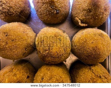 Sicilian Arancini Arranged On A Metal Tray And Displayed For Sale. Typical Sicilian Recipe. Famous I