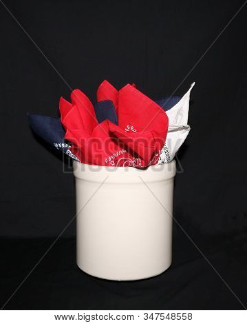 Stoneware Crock And Kerchiefs With Isolated Black Background