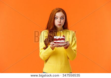 Funny And Silly Cute Redhead B-day Girl Squinting Eyes Making Goofy Expression, Pouting As Holding B