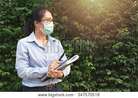 Young Asian Woman Wearing Glasses And Face Mask Protect Filter Pm2.5 Anti Pollution, Anti Smog And V
