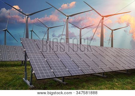 Renewable And Alternative Power Production Concept. Photovoltaic Solar Panels And Wind Turbines In P