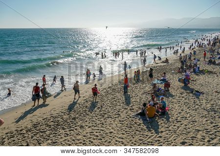 Crowded Santa Monica Beach With Tourist And Families Enjoying The Summer And Hot Weather. Santa Moni