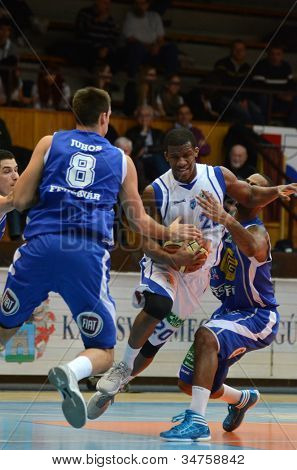 KAPOSVAR, HUNGARY - FEBRUARY 22: Kwadzo Ahelgebe (in white) in action at a Hungarian Cup basketball game with Kaposvar (white) vs. Fehervar (blue) on February 22, 2012 in Kaposvar, Hungary.