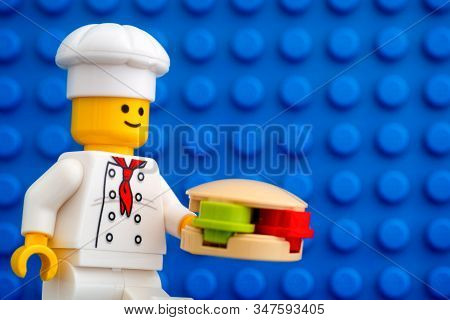 Tambov, Russian Federation - October 19, 2019 Lego Chef Minifigure With Hamburger Against Blue Basep