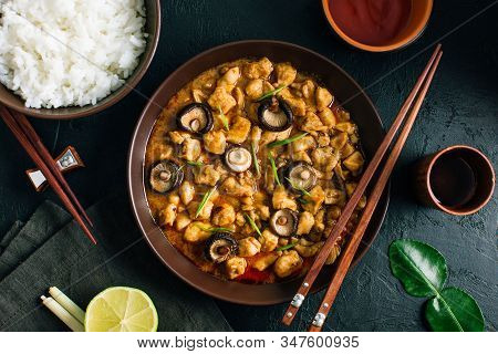 Panang Gai, Delicious Thai Food Of Chicken With Shiitaki Mushrooms On A Black Background