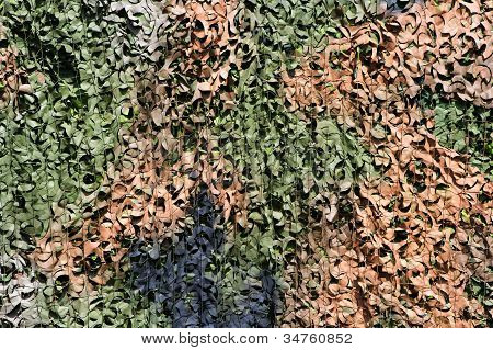 a multi color leaf camouflage net background poster