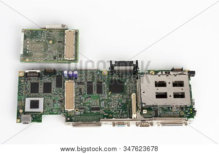Close Up Of Motherboard Old Laptop With Empty Socket Base For Cpu,  And   Laptop Processor With Coll