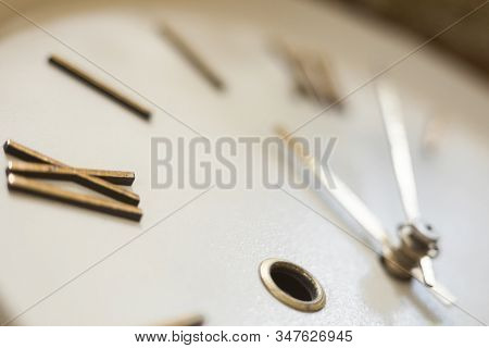 Clock Face Of The Old Wall Clock. Roman Numerals. Hour And Minute Hands. Time Concept. Close-up.