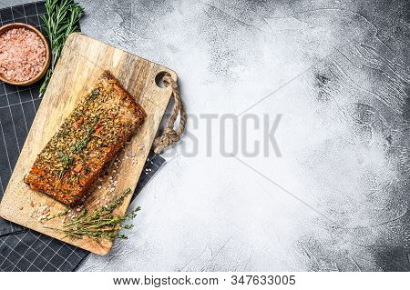 Homemade Hot Smoked Salmon Fillet On A Cutting Board. Trout. Gray Background, Top View, Space For Te