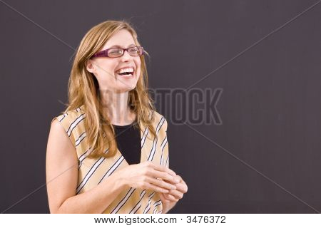 Laughing Instructor At Blackboard.