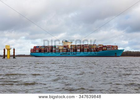 Stade, Germany - January 22, 2020: Container vessel ESTELLE MAERSK on Elbe river heading towards Hamburg.