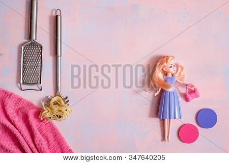 Housewife Cleaner. Lady Housewife, Fashionable Dress, Doll Fashion. The Girl Is Cooking Pasta. Copy