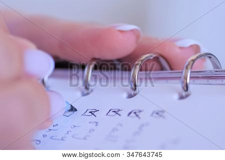 Woman Hand Putting Mark On Check Boxes Of To Do List In Personal Vintage Notebook Organizer - Close