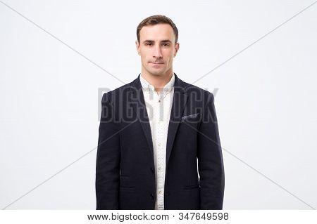 Portrait Of Strict Serious Businessman In Black Suit