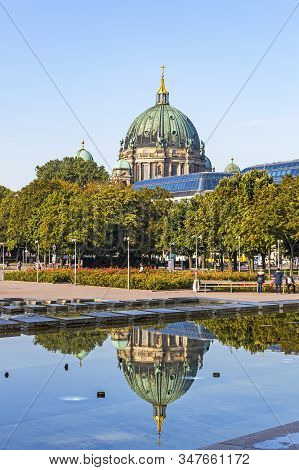 Tower Of Berlin Cathedral (berliner Dom), Famous Landmark Of Berlin, Germany. View From Neptune Foun