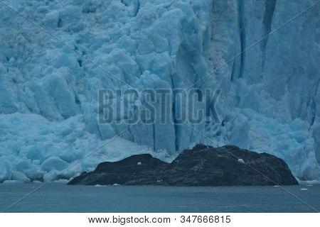 Glaciers Of Alaska Calving Into The Sea