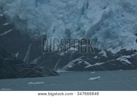 Glaciers Of Alaska Showing Their Beauty Calving Into The Sea
