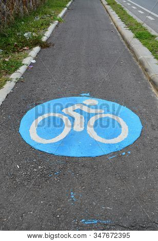 Blued Bicycle Lane On Asphalt Road - Sport And Healthy Lifestyle Concept