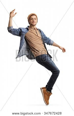 Full length shot of a young guy dancing on tiptoes isolated on white background