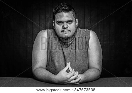 Black And White Angry Or Upset Latino Man With Arms Bared