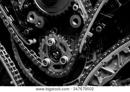 Gear, Chain Drive Shaft In Conveyor, Belt Is On Production Line. Timing Chain Of Car, Tensioners In