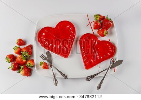 Sweet Gelatin Hearts Dessert In The White Dish With Fresh Strawberry. Valentines Day Concept.