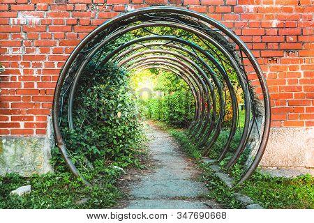 Abstract Symbolic Portal Or Passage In Brick Wall Made Of Metal Circular Bars