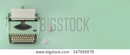 A Green Vintage Typewriter With Green Background And Two Paper Balls.